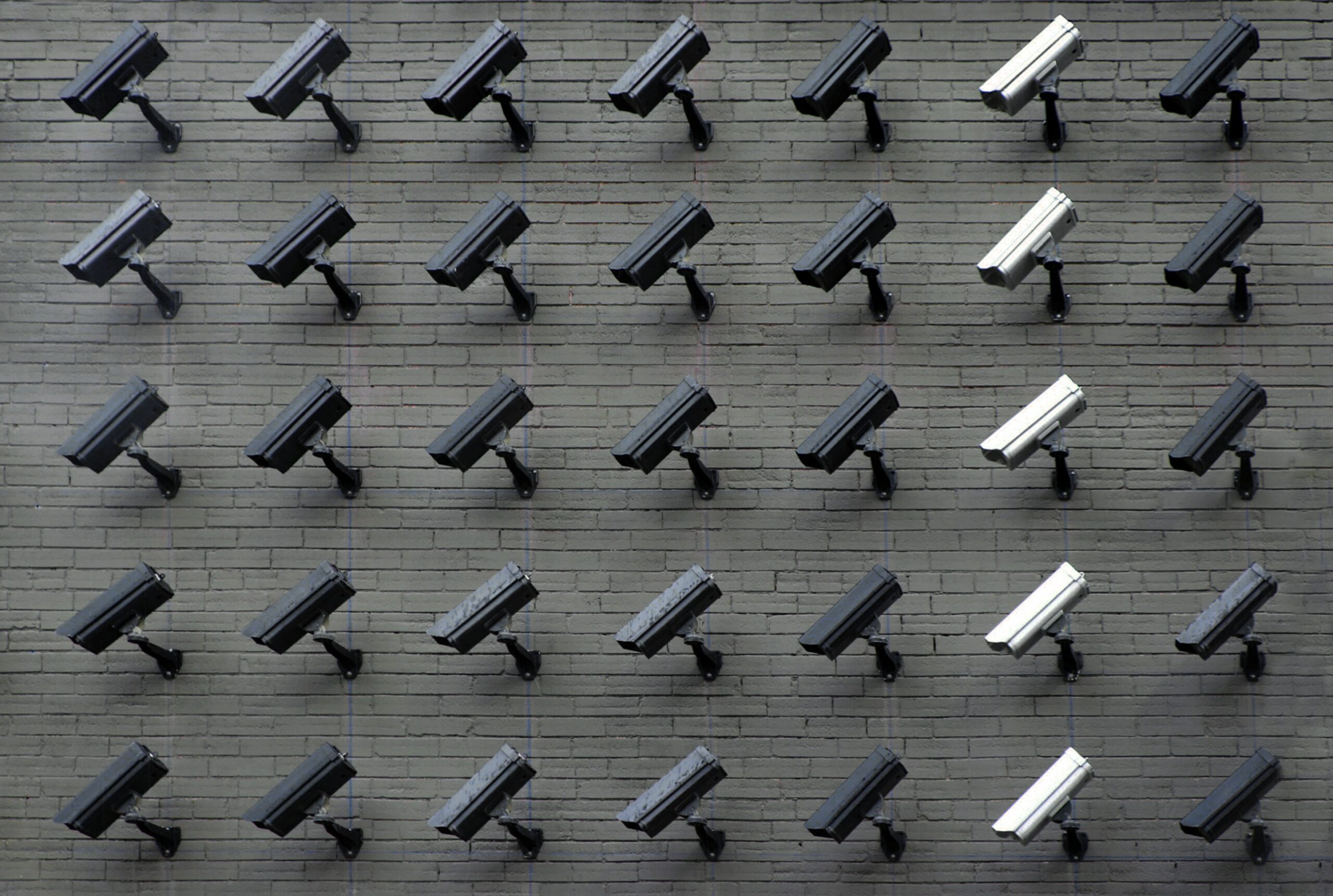 Assorted Security Cameras on a Wall